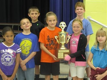 One student from each class in grade 3 getting picture taken with the Character Cup.