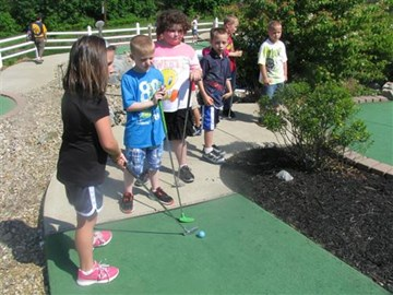 Students  showing good charactor while waiting for their turn at Putt-Putt!